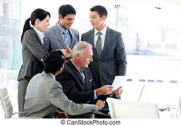 Multi-ethnic business team in a meeting - Multi-ethnic...