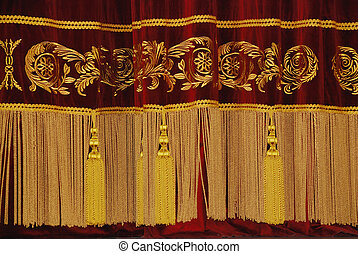 drape - wine-coloured drape with gold fringe and tassels