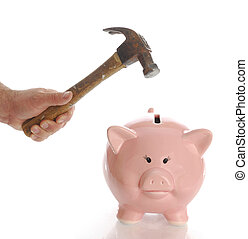 smashing piggy bank - man holding hammer aiming for pink...