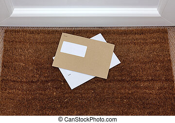 Envelopes on the doormat - Two envelopes on a doormat, blank...