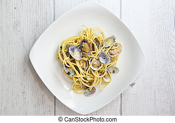 Spaghetti with fresh clams, garlic and parsley, focus...