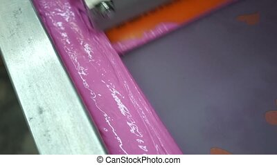 Industrial silk screen printing machine in action - Cloth...