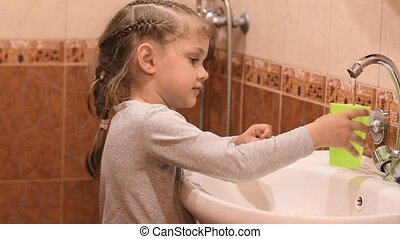 Five-year old girl rinsing mouth after brushing teeth