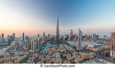 Dubai Downtown day to night timelapse view from the top in...