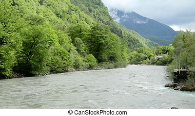rapid mountain river in Abkhazia in the spring morning, with...