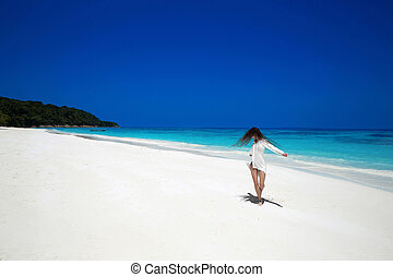 Carefree happy woman open arms on tropical beach, exotic...