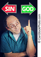 Adult man thinking what to choose between SIN and GOD -...