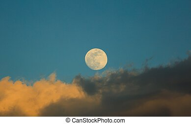 White moon over stormy clouds