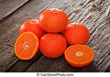 Halved and whole tangerines - Close-up of several halved and...