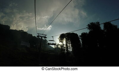 Lifts in mountains silhouettes