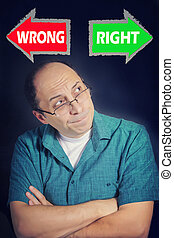 Adult man facing choice between RIGHT and WRONG - Portrait...