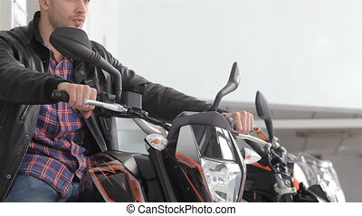 Man sitting on motorbike - Close up of consultant keeping...
