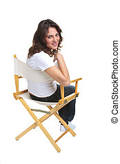 Woman sat on a chair looking back