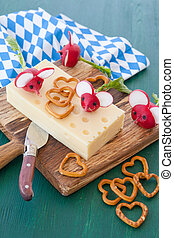 Block of hard cheese with radishes - Block with hard cheese...