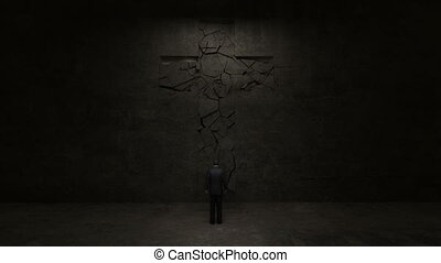 Man standing in front of holy cross on the black wall.