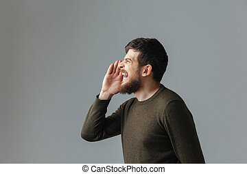 Side view portrait of a man shouting