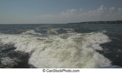 Waves from boats on the river - Water, waves from a boat on...