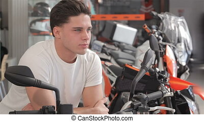 Buyer dreams on motorbike - Close up of a dreaming young man...