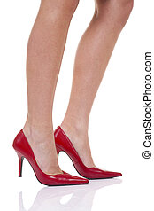 Womens legs in red high heel shoes - A womans legs with red...