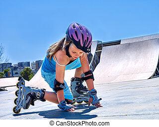Girl riding on roller skates in skatepark. - Child Girl...