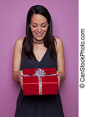 Woman happy as she receives a gift - A happy woman receiving...