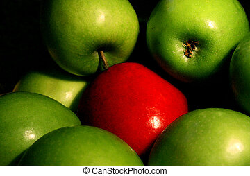 Odd one out - A bowl of green apples surround a single red...