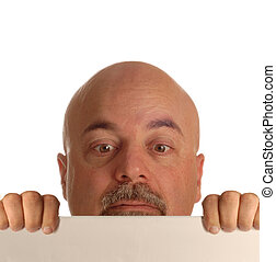 bald man looking over blank sign