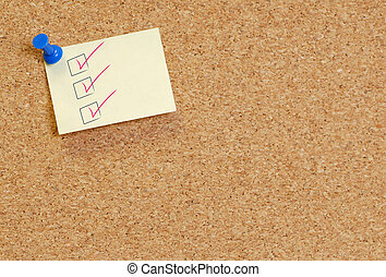 check list on corkboard - check list on note thumb tack to...