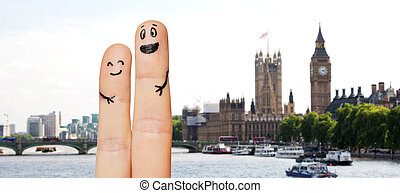 close up of two fingers with smiley faces - family, couple,...