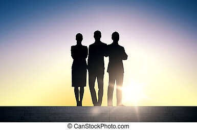 business people silhouettes on stairs over sun - business,...