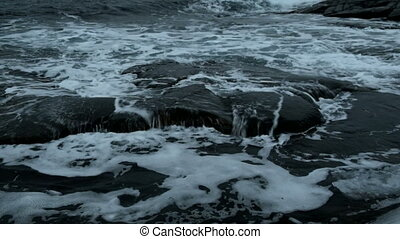 Waves break against a stone, the northern ocean. - Waves...