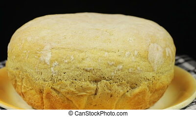 Homemade Bread on the Table Rotates on a Black Background -...