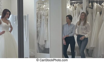 Beautiful Bride at the Clothes Shop for Wedding Dresses, she...
