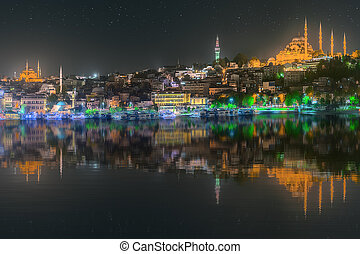 Istanbul skyline from Galata bridge by night, with...