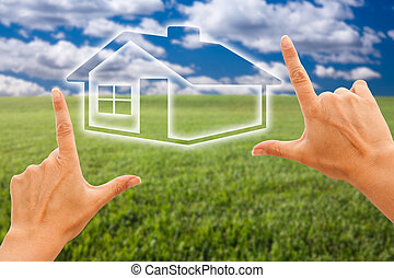 Female Hands Framing House Over Grass and Sky