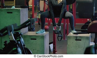 Young Woman Exercising at Gym.