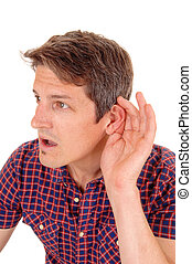 Jung man is hard of hearing. - A closeup image of a young...