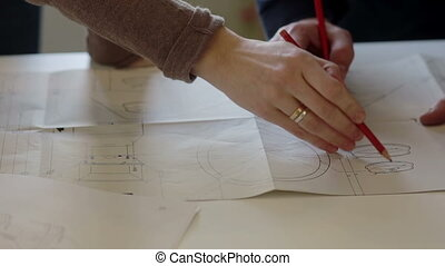Designer and worker discuss the plan of repair. - Worker...