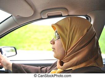 an a muslim woman in car, driver