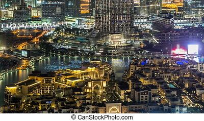 Dubai Downtown night timelapse view from the top in Dubai, United Arab Emirates
