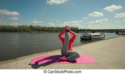 Young Brunette Woman Practicing Yoga Near River
