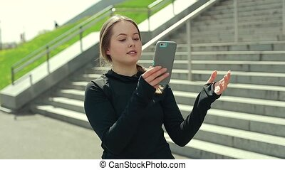 Young Girl Using Smartphone Outside.