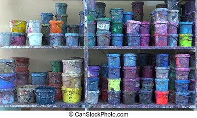 Industrial multicolor paint buckets storage 4K dolly shot