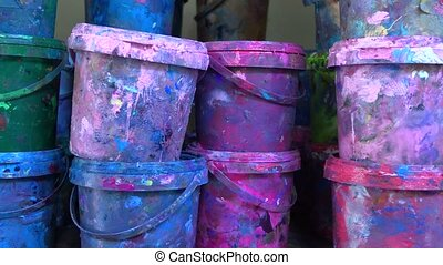 Industrial multicolor paint buckets storage 4K dolly shot,...