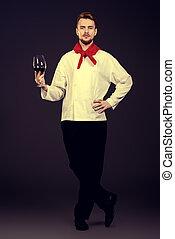 elegant sommelier - Male sommelier tasting red wine...