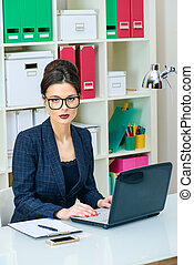 smart businesslady - Businesswoman working at the office....