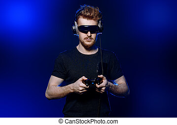 3d games - Passionate gamer with controller, headphones and...