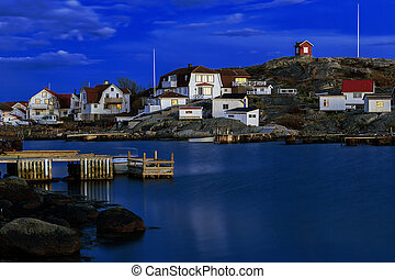 Swedish fishing village at night.