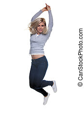 Blond woman jumping in the air