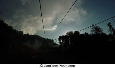 Lifts in mountains in summer - Shooting clouds and lifting...